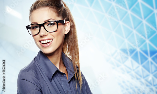 Closeup of young business woman giving you attractive smile