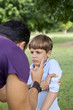 Parenthood and children education, angry man scolding boy in par