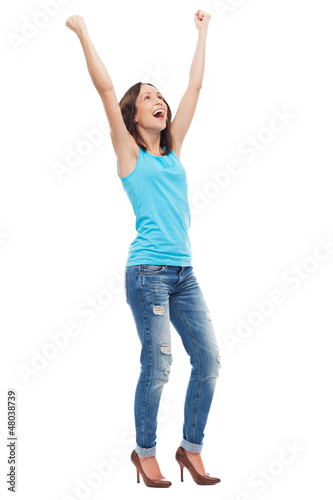 Happy young woman clenching fists