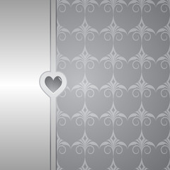 grey background with a pattern and a border with a heart