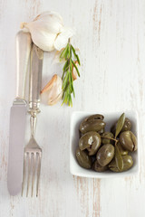olives in bowl with rosemary and garlic