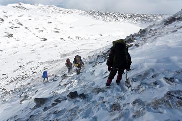 Hike in winter mountain.
