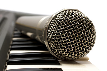 Microphone and electronic keyboard.  Are isolated on a white bac