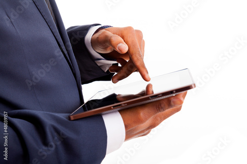 African American businessman working on a digital tablet, isolat