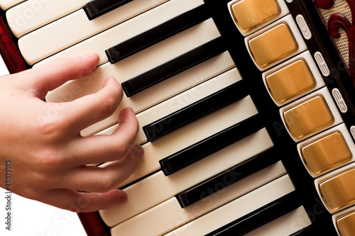 Hand playing accordion