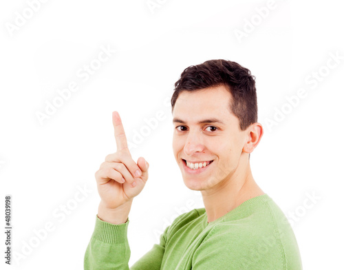 Portrait of happy young casual man pointing over white backgroun