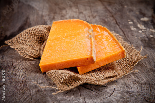 Delicious french yellow cheese on burlap