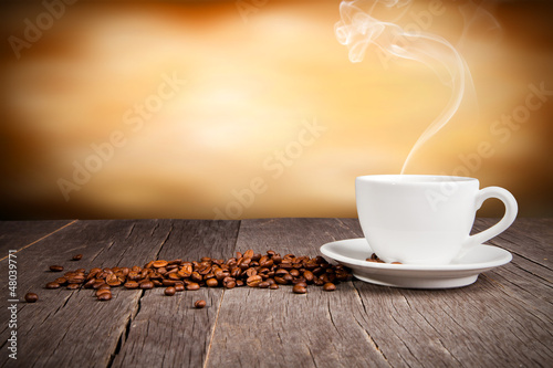 Fototapeta Cup of coffee on wooden table