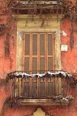 Romantic balcony with closed shutters in wintertime