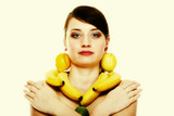 Healthy lifestyle - Young woman with fruits isolated
