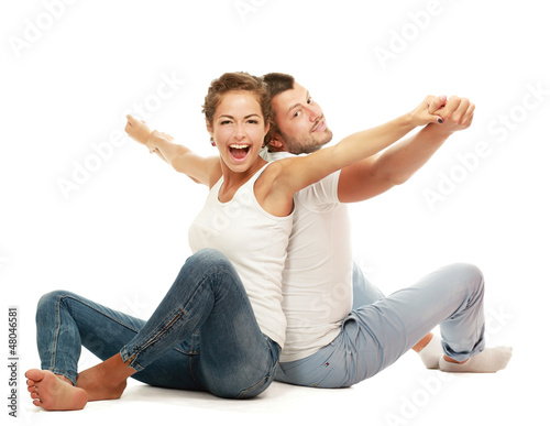 Portrait of young happy smiling couple sitting