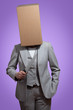 Business woman with a cardboard box head holding a knife