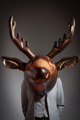 Woman with an inflatable deer head
