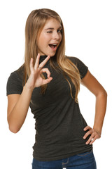 Young female with OK gesture winking
