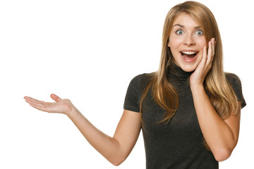 Surprised woman showing open hand palm with copy space