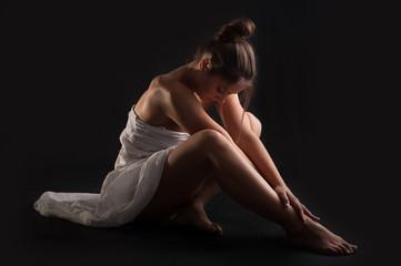 Intimate woman portrait wearing white dress