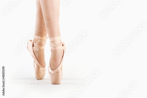 Feet close up of dancer isolated on white background.
