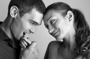 Romantic young couple studio portrait. Black and white image.