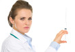Serious medical doctor woman holding syringe