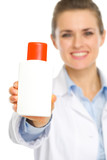 Closeup on bottle of sunscreen in hands of cosmetologist poster