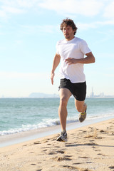Man running in the beach
