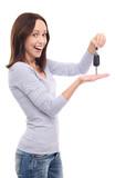 Young woman showing car key