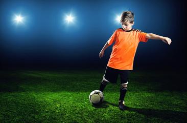 Child plays Soccer