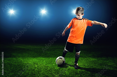 Child plays Soccer