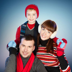 Happy family having fun at winter time