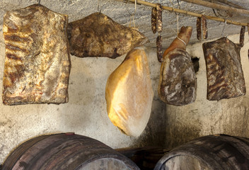 Interior of very old wine cellar with dried meat delicatessen
