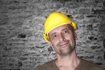 Friendly smiling worker with helmet