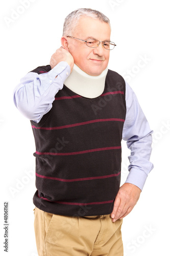An injured mature man with neck holder suffering from a pain