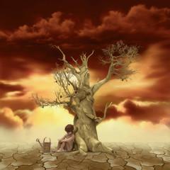 Niño Sentado Cerca de un árbol y regadera