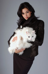 Portrait of sophisticated brunette woman with white Cat