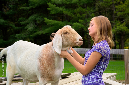Teenage Girl with her Goat