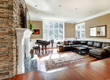 Bright luxury living room with stone fireplace