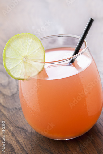 Refreshing tropical cocktail with fruit juice