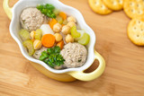 Chicpeas soup with meatballs and vegetables