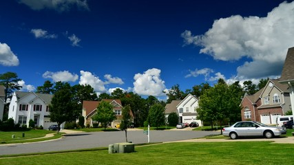 Time lapse of idyllic suburbs and rolling cumulus clouds
