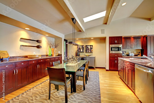 Luxury modern dining room with mahogany kitchen.