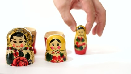 Matrioshka dolls placed in row and taken apart.