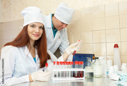 nurse and  doctor works  in clinic lab