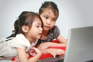 Kids Having Fun With Computer