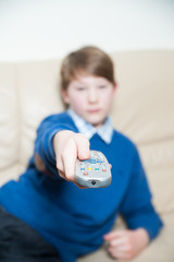 Boy with a Television Remote
