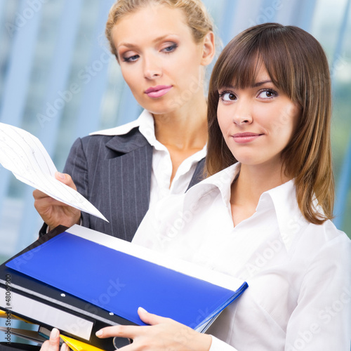 Businesswomen with documents at office