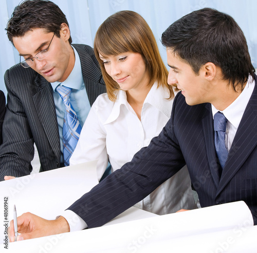 Three businesspeople working at office