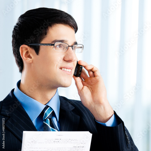Businessman with documents or contract and phone