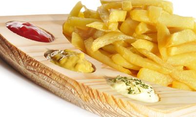 Detalle de patatas tres salsas.