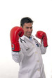 Portrait of young doctor wearing boxing gloves.