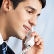 Portrait of young smiling businessman or call center worker